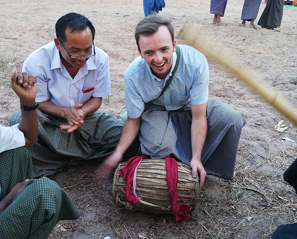Kip Hagberg holds a drum during his time with the Peace Corps