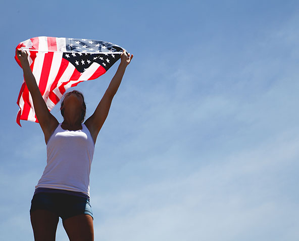 Photo of woman holding an American flag