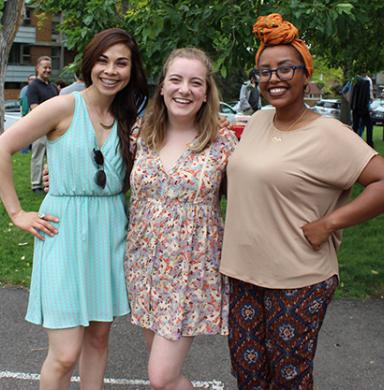 Three MFJS grad students pose at the end of the year picnic outside
