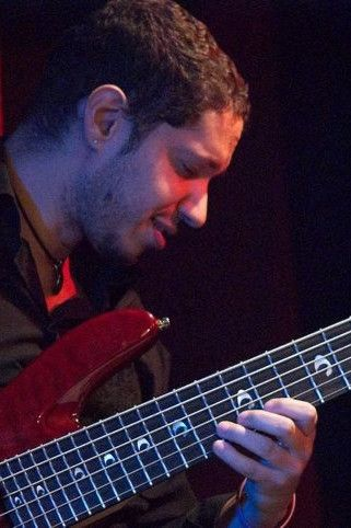"Eduardo ""Bijoux"" Barbosa playing the electric bass"