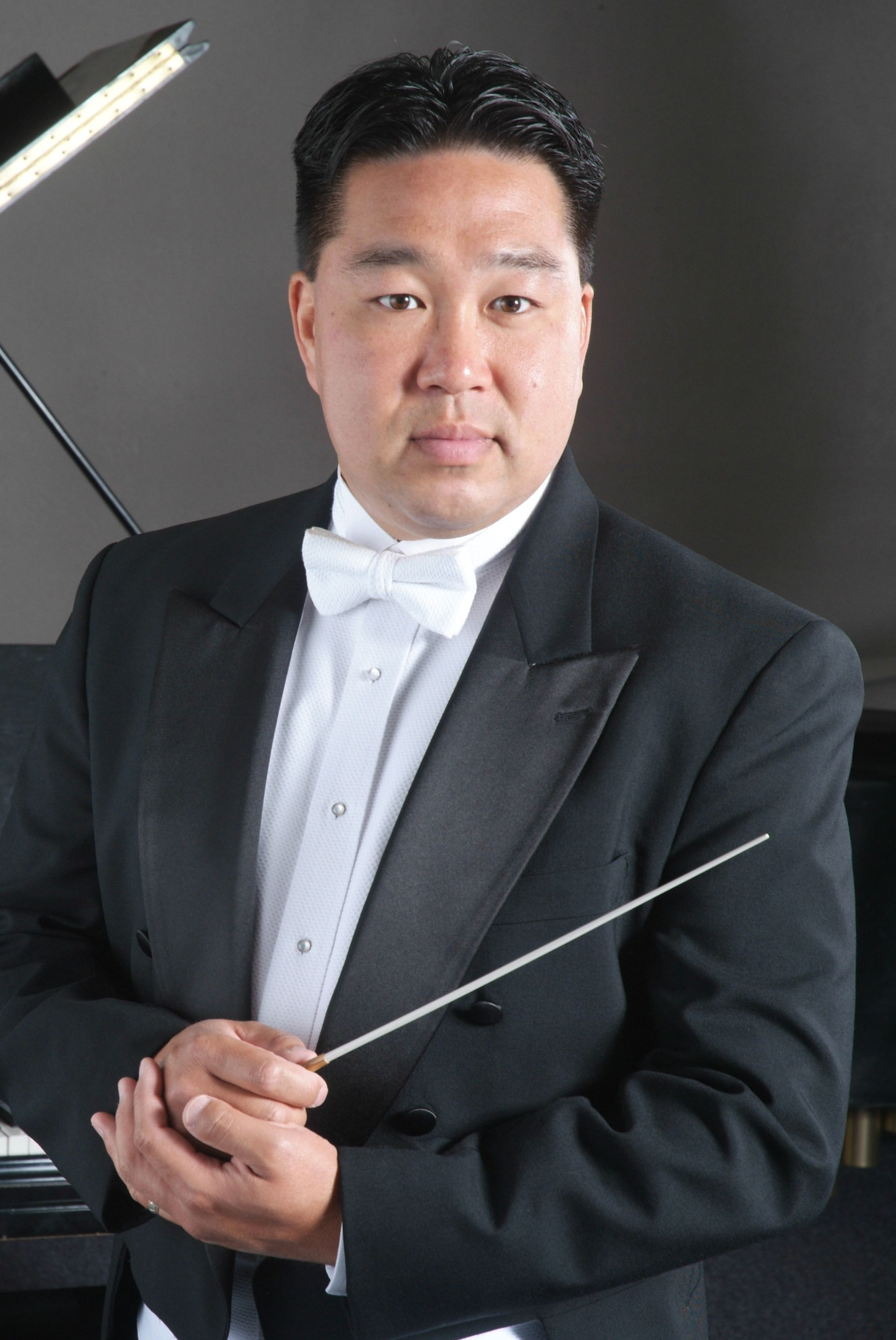 Kyle Fleming holding conductor's baton